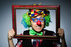 Funny clown with picture Royalty Free Stock Photos