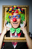 Funny clown with picture Stock Image
