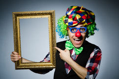 Funny clown with picture Stock Photography