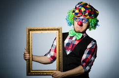 Funny clown with picture Stock Images