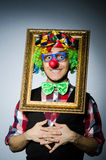 Funny clown with picture Royalty Free Stock Photography