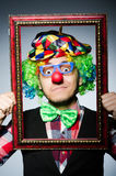 Funny clown. With picture frame Royalty Free Stock Photography