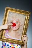 Funny clown. With picture frame Royalty Free Stock Image