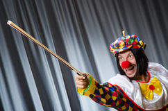 Funny clown plyaing violin Stock Photography