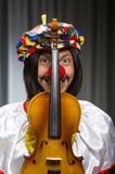 Funny clown plyaing violin Royalty Free Stock Photography