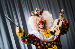 Funny clown plyaing violin Stock Images