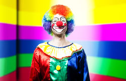 Funny clown portrait on colorful background Royalty Free Stock Images