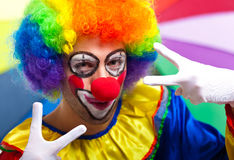 Funny clown posing on a colorful background Royalty Free Stock Photos