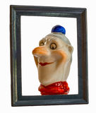 Funny clown with red nose in picture frame Stock Image