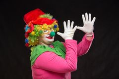 Funny clown in shiny glasses with good cheerful emotions. Funny curly clown in shiny glasses with good cheerful emotions Royalty Free Stock Image