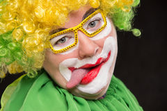 Funny clown in shiny glasses with good cheerful emotions Royalty Free Stock Photography