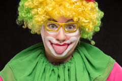 Funny clown in shiny glasses with good cheerful emotions Royalty Free Stock Images