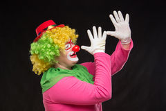 Funny clown in shiny glasses with good cheerful emotions Royalty Free Stock Photos