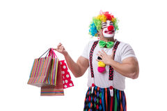 Funny clown after shopping bags isolated on white background Royalty Free Stock Photography