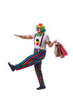 The funny clown with shopping bags isolated on white background Royalty Free Stock Images