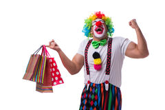 Funny clown after shopping bags isolated on white background Royalty Free Stock Photos