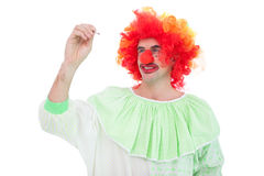 Funny clown smiling and writing Royalty Free Stock Photo