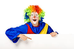 Funny clown standing over a white background Stock Images