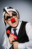 Funny clown with sticks Royalty Free Stock Photography