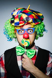 Funny clown. With sweet lollipop stock photography