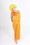 Funny clown with yellow hair and costume Royalty Free Stock Image
