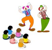 Funny Clowns. Clowns performing a fun show to a group of kids Royalty Free Stock Photos