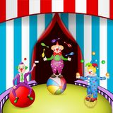 Funny clowns at the circus festival. With entertainment tools on white background Royalty Free Stock Photo