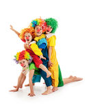 Funny clowns at the party. Group of little clowns at the party Stock Photo