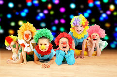 Funny clowns at the party. Group of little clowns dancing at the party