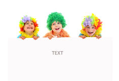 Funny clowns at the party with white blank Stock Images