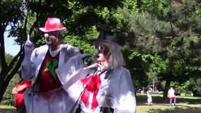 Funny clowns. Performing in the park stock video