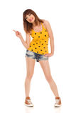 Funny Clumsy Girl Pointing Royalty Free Stock Image