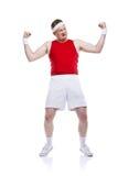 Funny clumsy sportsman. Funny weak sportsman exercising. Studio shot on white background Royalty Free Stock Photo