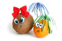 Funny coconut girl and orange boy Royalty Free Stock Photography
