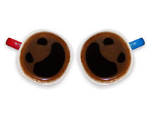 Funny coffee cups with smiley faces Stock Photos