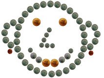 Funny coin smiley. Funny smiling face is decorated via US coins Stock Photos
