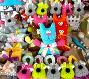Funny colored handmade toys n the form of cats. Funny colored handmade toys in the form of cats and dogs stock photography