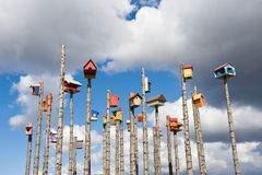 Funny colored nesting boxes on wooden columns, Iceland. Funny colored nesting boxes on wooden columns, on a background of a blue sky, Iceland Stock Image