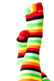 Funny colored socks female legs Stock Photography