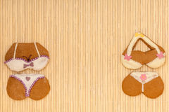 Funny colorful bikini shape gingerbread cakes cookies on bamboo mat Stock Image