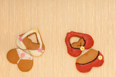 Funny colorful bikini shape gingerbread cakes cookies on bamboo mat Royalty Free Stock Photo