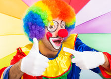 Funny colorful clown Thumbs up Stock Images