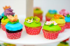 Funny colorful cupcakes Stock Image
