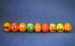 9 funny colorful Easter eggs with faces Royalty Free Stock Photography