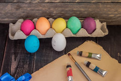 Funny colorful easter eggs with painting brush on old paper . Re Royalty Free Stock Photos