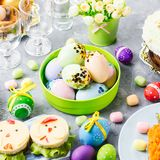 Funny colorful Easter food for kids with decorations on table. Easter dinner concept royalty free stock photography