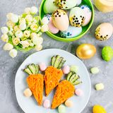 Funny colorful Easter food for kids with decorations on table. Easter dinner concept. Top view royalty free stock images