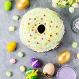 Funny colorful Easter food for kids with decorations on table. Easter dinner concept royalty free stock images