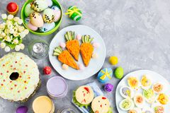 Funny colorful Easter food for kids with decorations on table. Easter dinner concept stock images