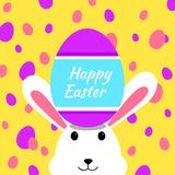 Funny and Colorful Happy Easter greeting card with rabbit, bunny illustration,eggs, and text royalty free illustration